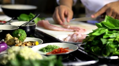 stock-footage-professional-chef-cooking-working-and-preparing-asian-food-and-sushi-in-restaurant-kitchen-rack